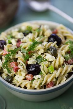 Summer Pasta Salad Recipe - A creamy Greek-inspired pasta salad with diced peppers, kalamata olives, fresh dill, scallions and capers coated in a feta-yogurt dressing. Be sure to use whole wheat pasta :)