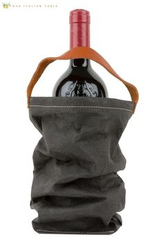 """This gift says, """"Saluti"""" to the wine lover in your life. This artisan-made sustainable wine bag features a leather handle and comes in a variety of colors. This is a perfect wine gift for the wine aficionado or anyone who brings the wine to dinner parties. #winetote #winetotes #winebag #winebags #madeinitaly #artisanmade #organic #sustainable #organicbags #ecobags #wine #hostessgift #hostessgifts #hostessgiftideas #holidaygifts #holidaygiftideas #holidaygift #winegift #winegiftideas"""