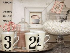 A beverage station also can be as simple as 1, 2, 3. Stock a tray with some mugs, hot cocoa mix, candy canes and marshmallows. It will take up very little space yet still do the job.
