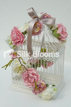 Vintage pink ivory rose birdcage wedding table centrepiece...prettier birdcages to use in house after wedding!!