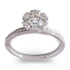Platinum Round Brilliant Diamond Daffodile Engagment Ring with Pave Diamond Shank.