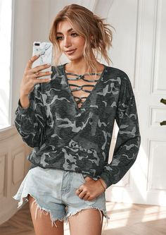 You can never go wrong with a staple long sleeve top as our In the Army Casual Long Sleeve Top. Delicate crisscross detail on the plunging v-neckline is undoubtedly eye-catching! The top features long sleeves with elastic cuffs of popular camo print fabric all over.