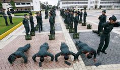 Women cadets do push-ups at a military training school in Bogota March 4, 2009. Female soldiers are taking part in the first ever course that will let them pursue careers as combat officers in the army. Picture taken March 4, 2009. REUTERS/John Vizcaino (COLOMBIA)