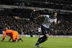 Tottenham Hotspur's English midfielder Harry Winks (R) celebrates after scoring Tottenham's first goal during the English Premier League football match between Tottenham Hotspur and West Ham United at White Hart Lane in London, on November 19, 2016