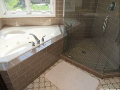 Master Bath with glass subway tile