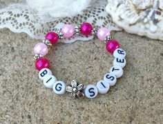 "This gorgeous handmade bracelet makes a great gift for the big sister of a new baby to be!  She'll feel extra special letting everyone know how excited she is!  This bracelet is made on an elastic band to ensure a good fit!  Can also be made as a set for the ""Little Sister"" too!  Just note your request at checkout!  Looking for a different color?  Just indicate the specific color request in the notes at checkout!  ******At checkout, please note: 1) the age of the child 2) pearl color of…"