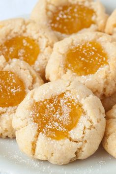 These soft and chewy gluten-free lemon thumbprint cookies are sure to perk up your day! @mybakingaddiction