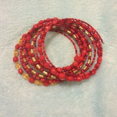 Orangey-Red Spiral Bracelet Your wrist will enjoy this pop of color to either match or coordinate with a fun summer maxi. Jewelry Bracelets