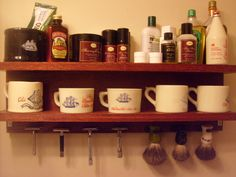 Shaving mug, razor, brush, and dressing products collection.