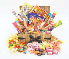 We are delighted to present our fabulous retrotasticLUXURY RETRO SWEET HAMPER that will satisfy anyone young or old with a sweet tooth! Presented in a tissue linedhigh quality Wicker effect keepsake box complete with lid and attached decorative ribbons.   eBay!