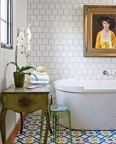 Colorful tiles in an otherwise all-white bathroom