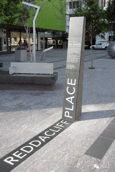 Effective but probably not suitable for crowded environment. Example of Signage incorporated into landscape using large type - Reddacliff Place Memorial, Brisbane Environmental Graphic Design, Environmental Graphics, Wayfinding Signs, Deco Restaurant, Outdoor Signage, Exterior Signage, Signage Design, Urban Design, Design Design