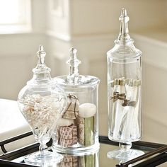 some clear glass accents...a great option are the Glass Apothecary Jars...use them anywhere...kitchen, master bath, etc.