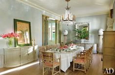 An 18th-century French crystal chandelier crowns the dining room, where Nicky Haslam added a carved-and-painted trellis-pattern dado.