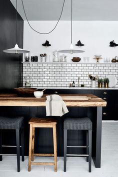 Monochrome industrial kitchen with metallic accents