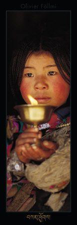 Tibetan Buddhist woman offering butter lamp