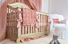 This silver lifetime crib is beyond when decked out in baby pink roses. #baby-bedding #girl,-baby-bedding, #brattdecor, #nursery, #baby-furniture