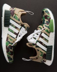 "Detailed photos of the BAPE x adidas NMD collaboration have finally surfaced, and the release is looking to be another instant classic in the history of streetwear collaborations. Arriving in two seperate colorways of ""Green Camo"" and ""Purple Camo,"" A Moda Sneakers, Sneakers Mode, Sneakers Fashion, Fashion Shoes, Mens Fashion, Adidas Sneakers, Black Sneakers, Sneakers Workout, Chunky Sneakers"