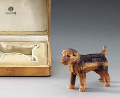 A TIGER EYE MODEL OF A BORDER TERRIER  by Fabergé, circa 1890  Realistically carved with two rose-cut diamonds, apparently unmarked, in original fitted case, the cover stamped in Cyrillic, 'K. Fabergé' with Imperial warrant 3½in. (9cm.) long