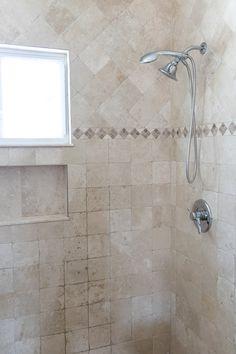 Travertine bathroom by Rauch Architecture PLLC