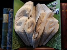 Hey, I found this really awesome Etsy listing at https://www.etsy.com/listing/209130268/golfer-folded-book-art-graduation-man