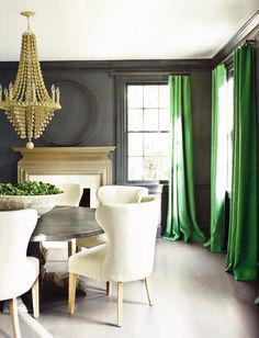 Green drapes in dining room.  www.budgetblinds.com