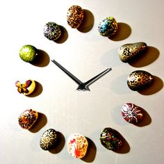 Stone Age Clock by Koon Art Design.  Stones are magnets arranged like clock face.
