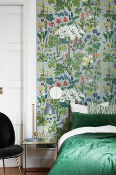 Green floral wallpaper in bedroom
