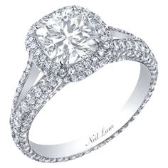 Neil Lane cushion cut diamond ring surrounded by diamonds set in platinum, R05005.