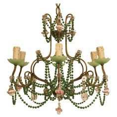 Italian Beaded Chandelier  Italy  1930's-1940's  Charming six arm light fixture, green glass beads and Italian blown glass drops.  Price  log in / registration  Condition*  Good vintage condition, with expected minor signs of age.