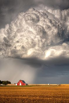"Amazing! Photo by Thomas Zimmerman. ""A violent thunderstorm builds on the plains of Kansas over a beautiful red barn in Ellis County, Kansas."""