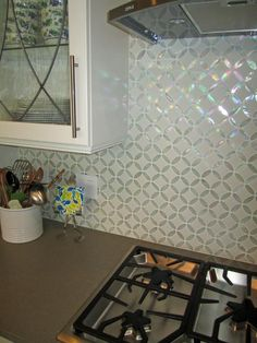 See this beautiful iridescent glass tile backsplash on HGTV.com.