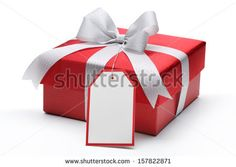 Red gift box with silver bow and tag by Sofiaworld, via Shutterstock
