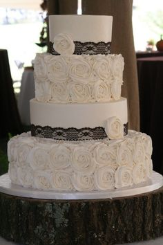 Rosette and Lace wedding cake @Chelsi Walls …this would match the cupcakes… use top 2 layers only