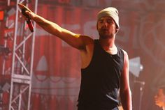Liam wearing a beanie and tank top is perfection