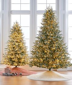 """A majestic recreation of a Fraser fir adorned with a fresh dusting of """"snow"""". The lush foliage, masterfully created from molds of natural cuttings, is lightly flocked and illuminated by thousands of warm white LED lights."""