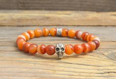 8mm - Orange agate beaded stretchy bracelet with gold skull 19e5a648c25d0