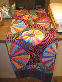 Cartwheel quilt by Liza Prior Lucy in the book, Kaffe Fassett's Quilt Grandeur. Spotted at Liberty of London.  Photo by Quilting Stores.