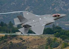 Lt. Col. George Watkins, the 34th Fighter Squadron commander, flies a combat-coded F-35A Lightning II aircraft past the control tower at Hill Air Force Base, Utah, Sept. 17, 2015.