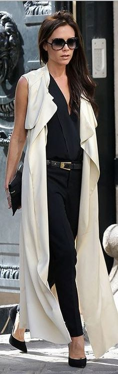 Victoria Beckham: Sunglasses – Cutler and Gross Jacket and purse – Victoria Beckham Collection Belt – Saint Laurent Shoes – Casadei