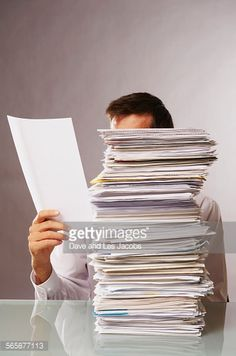 Stockfoto : Caucasian businessman reading stack of paperwork