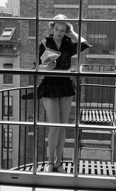 """City reading on balcony. """"A good book is an education of the heart. It enlarges your sense of human possibility, what human nature is, of wh..."""