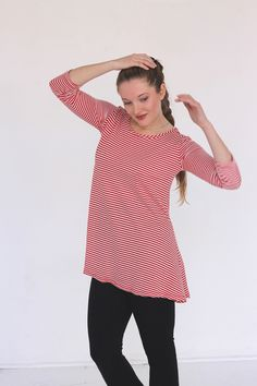 Women's Red and White striped Tunic Shirt. This striped tunic has a scoop neck and is fitted on top and flares at the hip. Made with 100% combed cotton. $39.00. jqlovesu.com