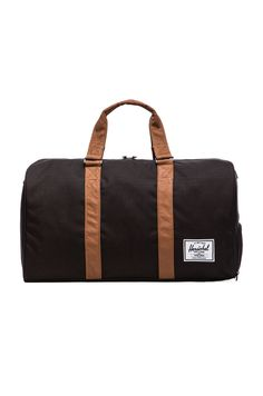 5a53e1c05a25 Herschel Supply Co. Novel in Black Baby In Snow