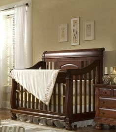 Convertible Sleigh Crib...the exact crib I want for our little ones!