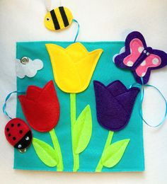New Page Tulips - a colorful, fun color matching game for your little one. Practice motor skills tucking and untucking the ladybug, bumble bee and butterfly in the coordinating tulip color. Comes with ribbons attached unless requested with out. Quiet Books are a great way to keep your little ones occupied and learning during church, doctors appointments, traveling, or anywhere you need to keep your children quietly entertained! Unique and thoughtful gift idea! Expand and change your book…