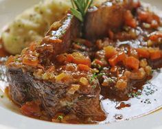 An easy entree for the Passover meal -- braised short ribs with tzimmes (sweet carrots).