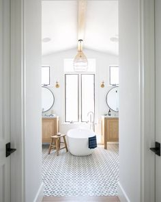 We're sharing beautiful bathrooms today that all pair warm wood vanities in golden tones with crisp white walls and marble. You're going to love the look. Bathroom Interior, Bathrooms Remodel, Bathroom Decor, Home, Interior, Bathroom Design, Beautiful Bathrooms, Bathroom Trends, Home Decor