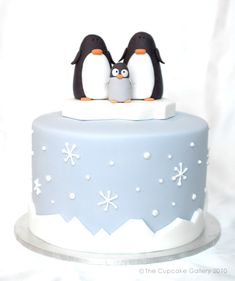 Arctic Winter Cake - Cupcake Gallery. Simple Christmas cake with cute penguins!