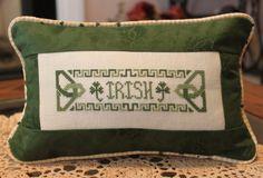 Irish Counted Cross Stitch pillow with piping edge. Cross Stitch Pillow, Just Cross Stitch, Counted Cross Stitch Patterns, Cross Stitch Embroidery, St Patrick's Cross, St. Patrick's Day Diy, Irish Cottage, Irish Girls, Letter Patterns